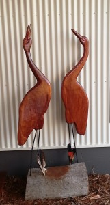 Matthew carved these brolgas from Queensland blue gum. They stand on an ironbark 'nest'